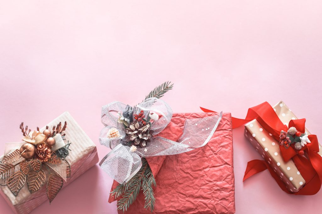Beautiful gift festive box on pink background, holidays concept